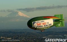 The Greenpeace A.E. Bates thermal airship flies over Seattle, Washington, with Mount Rainier in the background on March 25, 2016 urging Hillary Clinton to reject fossil fuel money in her campaign. The Democratic caucuses are March 26, 2016. Photo by Marcus Donner / Greenpeace.