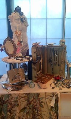 Brenda Schweder Jewelry display, great use of pleated curtains as the table skirt.