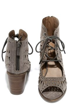 """There's no better time than the present to treat yourself to the Cut to the Chase Grey Suede Cutout Lace-Up Booties! Laser cut vegan suede is molded to a peep-toe upper with low cut collar, and lace-up vamp. 3"""" heel zipper."""