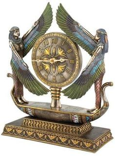 Invite the ageless beauty of ancient Egypt into your decor with the Design Toscano Wings of Isis Egyptian Revival Sculptural Desktop Clock . Egyptian Furniture, Egyptian Home Decor, Egyptian Art, Egyptian Temple, Egyptian Anubis, Egyptian Jewelry, Old Clocks, Antique Clocks, Mantel Clocks