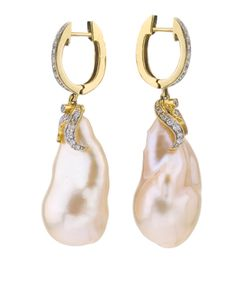 These 14kt Yellow gold Earrings have a beautiful pair of Ikecho Pearls.  Enhanced with diamonds, these are elegant for any occasion.  A wonderful custom design created by Jorge Adeler.