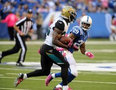 Oct 4, 2015; Indianapolis, IN, USA; Jacksonville Jaguars running back T.J. Yeldon (24) is pursued by Indianapolis Colts safety Mike Adams (29) during the second half  at Lucas Oil Stadium. Mandatory Credit: Thomas J. Russo-USA TODAY Sports