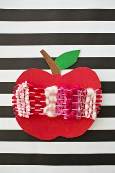Cardboard Apple Weaving Craft. Fun fall art apple project for kids. Beginner weaving and also great for practicing fine motor skills.