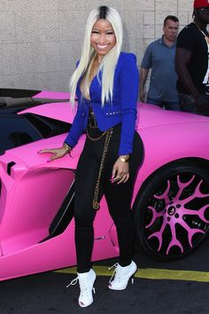 Nicki Minaj shows off her bubble gum pink Lamborghini after the launch of her 'Nicki Minaj' Collection at Kmart in Los Angeles
