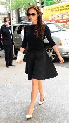 Shunning all black, Victoria Beckham opted for white heels and a white clutch to complete her ensemble.