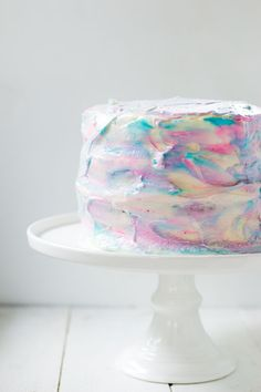 If you're expecting or planning a gender reveal party then this easy marbled gender reveal cake is perfect!