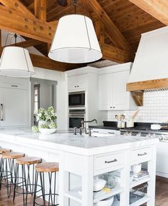 Husband and wife design team @studiomcgee worked their magic in this home, transforming this it into a cozy place to escape in Park City, UT featuring our Conical drum pendants in the kitchen. Link in profile to @studiomcgee's blog where you can see the full before & after. Photo by @travisj_photo #myonepiece #studiomcgee #canyonsproject #parkcityutah #whitekitchen
