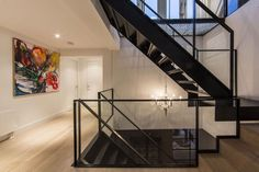 Apartments Family Apartment in Amsterdam Flaunting Permanent Visual Connection Between Spaces: Awesome Interior Design With Wood Flooring In Laminating Model Plus One Luxury Of Pendant Light Plus Two Wohite Door In Wood Also One Ceilling Light