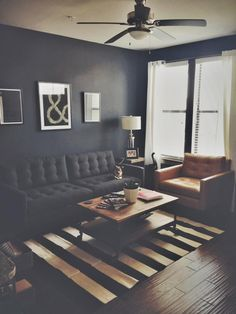 """A little too dark for my taste but we have a similar looking coffee table and window set up.  I also liked the overall style and simplicity.  """"The couch, sofa and rug are from Crate & Barrel. The coffee and side tables are from World Market. The magazines on the desk are from Offscreen and PRINT. The wall art is from Society 6."""""""