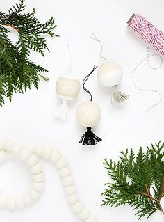 Hey everyone! Caitlin and Manda from The Merrythought here! Today we'll be sharing some super simple DIY wooden tassel ornaments for all the minimal lovers like ourselves. We've been using plywood and