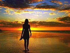 on beach at sunset wallpaper
