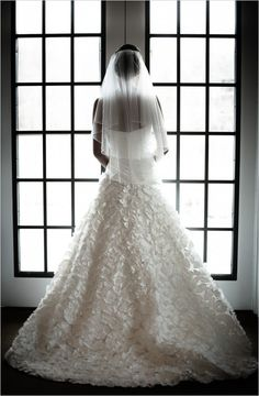 Incredibly gorgeous gown covered in petals. Captured By: Daniel Fugaciu Photography #wchappyhour ---> http://www.weddingchicks.com/2014/06/06/wedding-chicks-happy-hour-11/