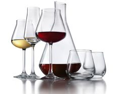 """Reuters: New wine glasses aim to balance """"water and fire"""" -   Could a wine glass shaped roughly like a closed tulip blossom revolutionize the savoring of fine vintages by taming the alcohol in the wine? For more click on the picture above."""
