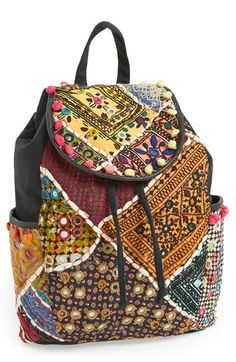 Free shipping and returns on Topshop Patchwork Backpack at Nordstrom.com. Myriad motifs and playful poms perfect the boho-chic vibe of this colorful backpack that's sure to stand out from the crowd.