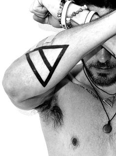 Thinking about getting a symmetric tattoo like Jared Leto has on both of his forearms... just an idea :-) #triad