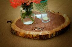 Table centerpieces.. We used a cedar tree that was cut down and had them cut into slices, then I burned our initials into them. :)