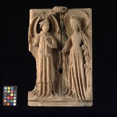 St Michael weighing souls with the Virgin interceding (Panel) - V & A, England 15th C, carved, painted & gilt alabaster.  (the Virgin stretches out her rosary to redress the balance in favour of mercy)
