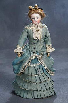 """Theriault's Antique Doll Auctions - An All-Original French Bisque Poupee by Gaultier 12"""" - Gaultier, circa 1875. Original wig, body and well-detailed original aqua and ivory walking suit, undergarments, stockings, shoes, bonnet, earrings, brooch with lorgnette."""