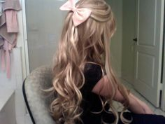 This looks like a five year olds hair, but for some reason I love bows.. I blame cheerleading haha