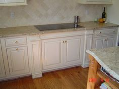 White Painted Kitchen Cabinetry with Column and Beading Details