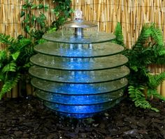 Glass disc water feature is a sphere