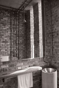 Great bathroom in the British India Offices by Kevin Low (Malaysian Architect) - industrial romantic..