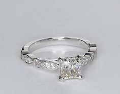 Vintage-inpired, this diamond engagement ring is crafted in 14k white gold and features petite diamonds set in a marquise and dot pattern with milgrain edges to frame your center diamond. Setting includes 1/5 carat total diamond weight. #bluenile