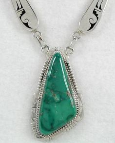 Fox Mountain Turquoise pendant with collar by Bennie Ration, Navajo silversmith.