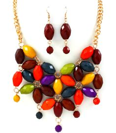 Colorful Maxi Necklace & Earring Set  $25This multi colored beaded necklace is a true statement piece! The vibrancy of the beads is fantastic and this is definitely a necklace that when worn can only make you feel happy and confident.