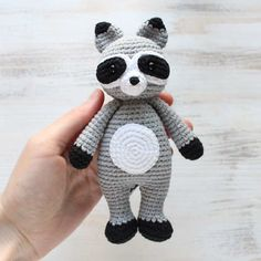 The Cuddle Me Raccoon Amigurumi Pattern includes detailed instructions and numerous pictures to guide you through the process of creating a nice crochet toy.