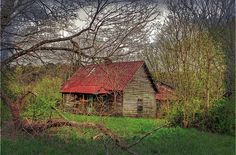 I imagine this an old home once on a dirt road.  Kids played barefoot in the yard and fished in the little lake down the road.
