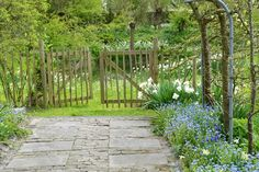 Nice rustic gate from a garden in Holland. I also like the stonework