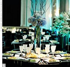 Simple, tall blue hydrangea centerpieces with branches (which could be silver)
