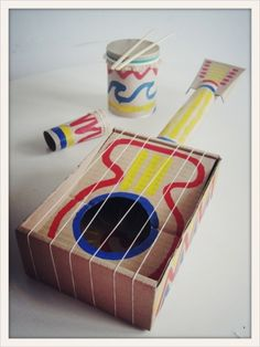 "Fun to make instruments and have an ""orchestra"" play at the end of the year in class! cool diy guitar + musical instruments for kids Kids Crafts, Projects For Kids, Diy For Kids, Homemade Instruments, Music Instruments Diy, Music For Kids, Diy Toys, Craft Activities, Cool Diy"