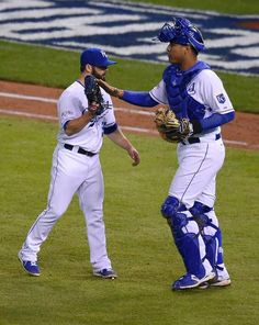 Kansas City Royals relief pitcher Tim Collins and Kansas City Royals catcher Salvador Perez celebrate after beating the San Francisco Giants in game six of the World Series on Tuesday, October 28, 2014 at Kauffman Stadium in Kansas City, Mo. The Royals beat the Giants 10-0.