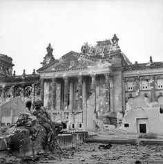 WWII. The Reichstag after being bombed,  most of Berlin was in ruins.