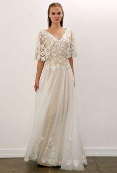 Tadashi Shoji - Fall 2012. Organza A-line wedding dress with a v-neckline, floral applique bodice, and three-quarter length sleeves, Tadashi Shoji