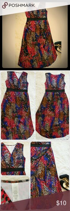Avon High-Low Leopard Print Dress Avon vibrant leopard print dress with high-low silhouette in size L. Avon size L fits 14-16. Only worn once, in excellent condition. Top: 95% Polyester, 5% Spandex. Skirt and lining: 100% Polyester Avon Dresses High Low