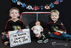 Hockey family's newest fan - Heartprint Images A sports-themed newborn session with an Anaheim Ducks little fan recruit.