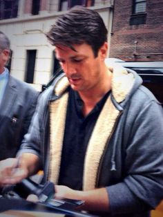 May 08,2014: Nathan Fillion signing autographs outside Letterman studio.