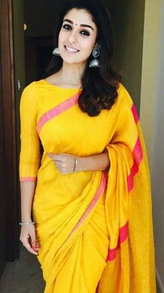 Nayanthara wearing silk saree with puffed sleeves Nayanthara wearing yellow colour raw silk saree with boat neck blouse
