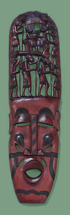 Large Kenyan African Mask with Family Tree Carving - Add some African art to your walls with this Over-Sized Kenyan Family Tree Mask. Masks are a long tradition in African art. This hand-carved mask depicts a face with an African family over the head. It is a celebration of the African carving technique and the African family.  Each mask is hand carved by African artisans in Kenya.  #africa #african #africanart #artwork #homedecor #mask #carving #woodcarving #interiordesign #art