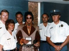 July 22, 1975: Elvis met with police in Greensboro, NC to receive his official Greensboro deputy badge.