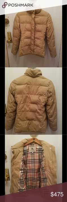 Burberry tan goose feather down jacket size XS My jacket  purchased by me for 1500 us +tax   Very warm classic Burberry lining  light wear on sided pockets  and on  elastic sleeve ends had a hood that zipped in I removed since  don't like hoods zipper is covered so not seen as missing something  full zip up closure  and flap over it with snap closures  snaps and zipper have Burberry engraved on it  26 length 15 1/2 shoulder wide about 25 sleeve  just dry cleaned it $45 but label state its…