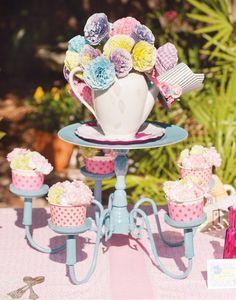 Sorta love this tea cups on chandelier.