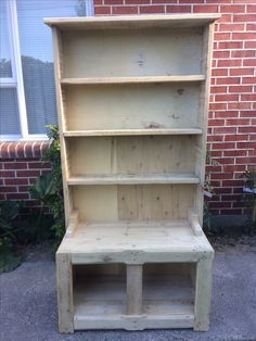 This Bookcase/shelf is 100% made from recycled pallet timber. The center petition on the bottom shelf comes out. You only need this to support the weight of the book on top.
