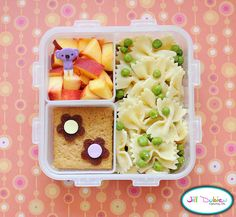 from meet the dubiens blog    This next one will be great for an afternoon nutrition break. There's cold pasta salad made with 'butterfly' pasta, a little italian dressing, peas and parmesan cheese. A sliced nectarine with a cute pick and a couple graham crackers with fruit leather and sprinkle flowers.