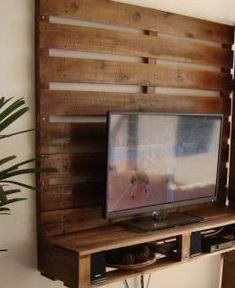This could go on the newly created back wall. TV could either go on the shelf, or could be mounted directly to the pallet.