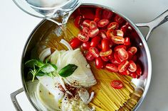 One pan pasta: pasta, tomatoes, basil, garlic, red pepper flakes, water and cheese