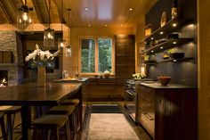open shelving + lighting + live edge timber table in dark wood kitchen by Carlton